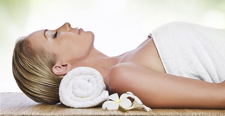 Woman laying in Towel shutterstock_750x387